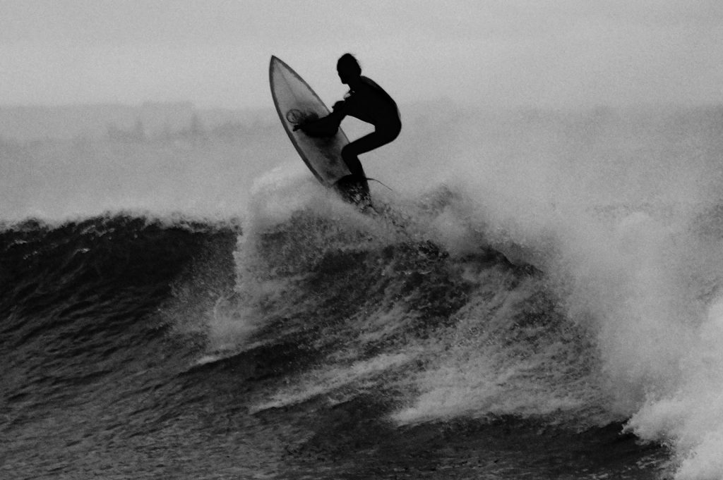 black and white surfer on wave