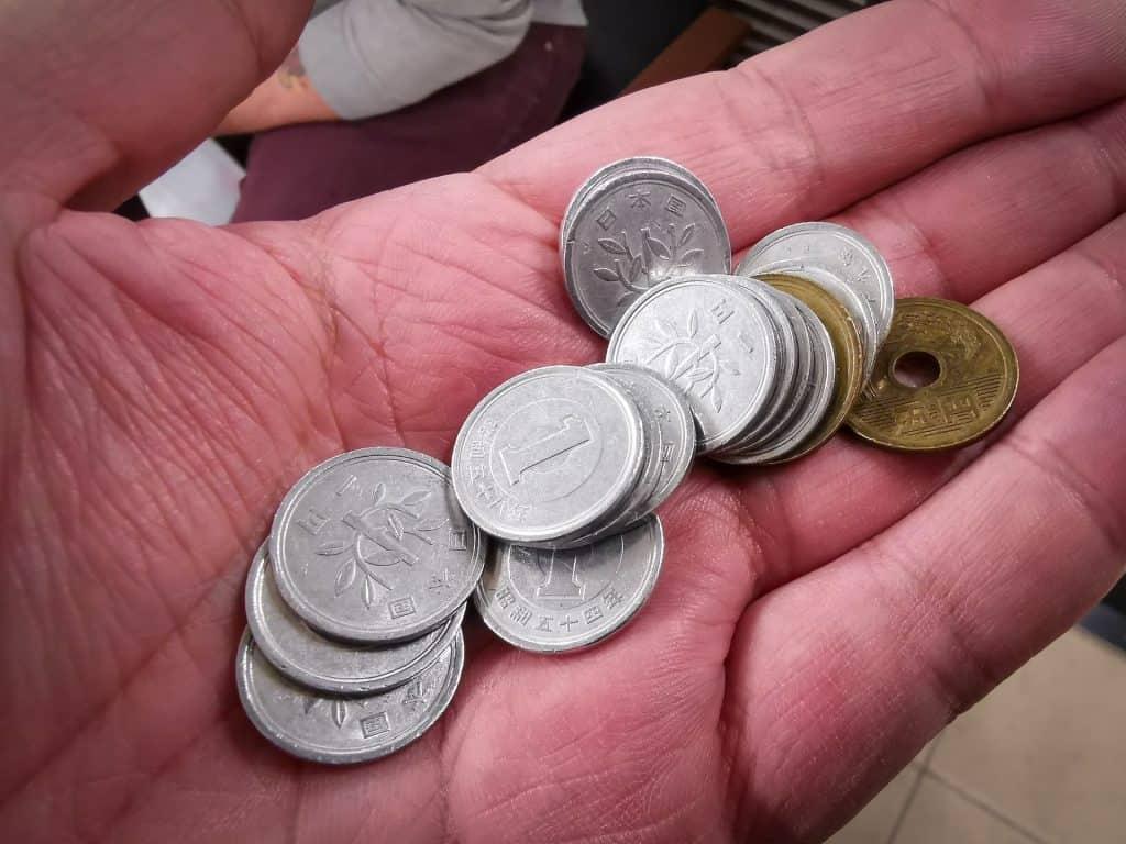 Japanese yen coins in hand